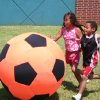 Summer day campers Chelle Seal (left) and Tyler Santiago, both of Noble, race to the soccer ball as they play giant soccer at the Movin' & Groovin' summer day camp at the J. D. McCarty Center in Norman. Giant soccer was just one of many sports and games the campers participated in during the week long camp. Community Photo By: Greg Gaston Submitted By: Greg,