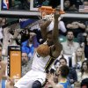 Utah Jazz\'s Derrick Favors (15) dunks the ball as New Orleans Hornets\' Ryan Anderson (33) watches in the second quarter during an NBA basketball game Wednesday, Jan. 30, 2013, in Salt Lake City. (AP Photo/Rick Bowmer)