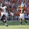 Oklahoma State\'s Jeremy Smith (31) runs in for a score as Texas\' Kenny Vaccaro (4) chases him down during second half of a college football game between the Oklahoma State University Cowboys (OSU) and the University of Texas Longhorns (UT) at Darrell K Royal-Texas Memorial Stadium in Austin, Texas, Saturday, Oct. 15, 2011. Photo by Sarah Phipps, The Oklahoman
