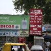 Photo - A billboard for wholesale rate of cancer medicines is seen outside a chemist store, in New Delhi, India, Monday, April 1, 2013. India's Supreme Court on Monday rejected drug maker Novartis AG's attempt to patent a new version of a cancer drug Glivec in a landmark decision that healthcare activists say ensures poor patients around the world will get continued access to cheap versions of lifesaving medicines. (AP Photo/Manish Swarup)