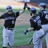 Photo - Colorado Rockies' DJ Lemahieu high fives with Charlie Blackmon after his solo home run against the San Diego Padres in the fifth inning of a baseball game Wednesday, Aug. 13, 2014, in San Diego. (AP Photo/Lenny Ignelzi)