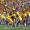 West Virginia quarterback Clint Trickett (9) signals his reciever during the second quarter of an NCAA college football game against Oklahoma State in Morgantown, W.Va., on Saturday, Sept. 28, 2013. (AP Photo/Tyler Evert) ORG XMIT: WVTE307
