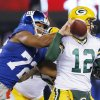 New York Giants defensive end Osi Umenyiora (72) knocks the ball away from Green Bay Packers\' Aaron Rodgers (12) during the first half of an NFL football game, Sunday, Nov. 25, 2012, in East Rutherford, N.J. (AP Photo/Julio Cortez)