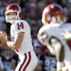 Photo - OU quarterback Sam Bradford, left, will be back in the spotlight on Saturday against BYU.  Photo by BY NATE BILLINGS, THE OKLAHOMAN
