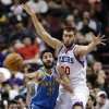 Photo - New Orleans Hornets' Greivis Vasquez (21) passes the ball as Philadelphia 76ers' Spencer Hawes defends during the first half of an NBA basketball game, Tuesday, Jan. 15, 2013, in Philadelphia. (AP Photo/Matt Slocum)