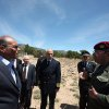 Photo - This photo provided by the Tunisian Presidency shows Tunisian President Moncef Marzouki, left, and Chief of Staff Rachid Ammar, second right, visiting military forces in Jebel Chaambi, western Tunisia and close to the Algerian border, Tuesday, May 7, 2013. Tunisia's Defence Ministry says the army has surrounded a group of armed militants holed up in a mountain stronghold protected by homemade fertilizer bombs. (AP Photo/Tunisian Presidency)