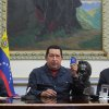 In this photo released by Miraflores Press Office, Venezuela\'s President Hugo Chavez, center, holds up a copy of national constitution as President of the Assembly Diosdado Cabello, left, and Vice- President Nicolas Maduro looks on during a televised speech form his office at Miraflores Presidential palace in Caracas, Venezuela, Saturday, Dec. 8, 2012. Chavez announced Saturday night that his cancer has returned and that he will undergo another surgery in Cuba. Chavez, who won re-election on Oct. 7, also said for the first time that if his health were to worsen, his successor would be Vice President Nicolas Maduro.(AP Photo/Miraflores Press Office, Marcelo Garcia)
