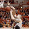 OSU\'a Philip Jurick (44) get caught between Texas A&M\'s Ray Turner (35) and Dash Harris (5) in the first half of a men\'s college basketball game between the Oklahoma State University Cowboys and Texas A&M University Aggies at Gallagher-Iba Arena in Stillwater, Okla., Saturday, Feb. 25, 2012. OSU won, 60-42. Photo by Nate Billings, The Oklahoman