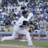 Photo - Los Angeles Dodgers starting pitcher Hyun-Jin Ryu throws during the second inning of Game 3 of the National League baseball championship series against the St. Louis Cardinals Monday, Oct. 14, 2013, in Los Angeles. (AP Photo/David J. Phillip)