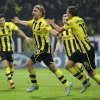 Photo -   Dortmund's Marcel Schmelzer, center, celebrates with teammates after scoring his side's second goal during the Champions League Group D soccer match between Borussia Dortmund and Real Madrid in Dortmund, Germany, Wednesday, Oct. 24, 2012. (AP Photo/Frank Augstein)