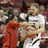 Louiosville\'s Monique Reid, left, battles Purdue\'s Sam Ostarello for a the ball during the first half of their second round game in the women\'s NCAA college basketball tournament in Louisville, Ky., Tuesday March 26, 2013. (AP Photo/Timothy D. Easley)