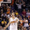 Phoenix Suns\' Goran Dragic, of Slovenia, shouts in celebration after making a 3-point shot against the Golden State Warriors during the second half of an NBA basketball game Saturday, Feb. 8, 2014, in Phoenix. The Suns won 122-109. (AP Photo/Ross D. Franklin)