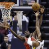 Indiana Pacers forward Paul George, right, holds down Chicago Bulls forward Luol Deng as he shoots in the first half of an NBA basketball game in Indianapolis, Monday, Feb. 4, 2013. (AP Photo/Michael Conroy)