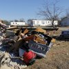 A view of a destroyed mobile home while other mobile homes across the road are still standing at the Bar K Mobile Home Park in Lone Grove, Okla., Wednesday, February 11, 2009. On Tuesday, February 10, 2009, a tornado moved through Lone Grove killing at least eight people. BY NATE BILLINGS, THE OKLAHOMAN