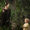 Photo - This image released by Disney shows Angelina Jolie as Maleficent, left, in a scene with her daughter Vivienne Jolie-Pitt, portraying Young Aurora, in a scene from the film,