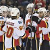 Photo - Calgary Flames Sean Monahan (23), Markus Granlund (60), Joe Colborne (8) and Mark Giordano (5) celebrate a goal against the Edmonton Oilers during the first period of an NHL hockey game, Saturday, March 1, 2014 in Edmonton, Alberta. (AP Photo/The Canadian Press, Jason Franson)