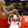 Oklahoma City\'s Kevin Durant takes the ball past Houston\'s Jermaine Taylor and Chuck Hayes during their NBA basketball game at the OKC Arena in downtown Oklahoma City on Wednesday, Nov. 17, 2010. Photo by John Clanton, The Oklahoman