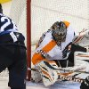 Winnipeg Jets\' Blake Wheeler (26) is stopped by Philadelphia Flyers\' goaltender Ilya Bryzgalov during the third period of an NHL hockey game in Winnipeg, Manitoba, Tuesday, Feb. 12, 2013. (AP Photo/The Canadian Press, Trevor Hagan)