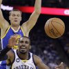 Memphis Grizzlies\' Mike Conley (11) loses the ball while driving against Golden State Warriors\' Andris Biedrins during the first half of an NBA basketball game Friday, Nov. 2, 2012, in Oakland, Calif. (AP Photo/Ben Margot)