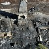 In this aerial photo, law enforcement authorities investigate the charred remnants of a cabin Wednesday, Feb. 13, 2013 in the Angeles Oaks area of Big Bear, Calif. An official briefed on the investigation tells The Associated Press that a wallet with a California driver\'s license with the name Christopher Dorner has been found in the rubble of a cabin. A charred body was also found inside after a shootout and fire. Authorities believe the remains are those of the former Los Angeles police officer, but they have not been formally identified. (AP Photo/The Sun, John Valenzuela)