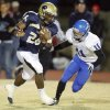Photo - Heritage Hall's Barry Sanders (26) tries to get past Caden Locke (11) of Bridge Creek in the first quarter during the high school football playoff game between Bridge Creek and Heritage Hall at Heritage Hall School in Oklahoma City, Friday, Nov. 19, 2010. Photo by Nate Billings, The Oklahoman