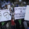Occupy Denver protesters hold signs as they rally against the presidential debate, which was being held on the University of Denver campus Wednesday, Oct. 3, 2012, in Denver. (AP Photo/The Denver Post, Hyoung Chang) MAGS OUT TV OUT ONLINES OUT ORG XMIT: CODEN504