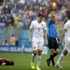 Photo - United States' Omar Gonzalez is given a yellow card by referee Ravshan Irmatov from Uzbekistan after an incident involving Germany's Bastian Schweinsteiger, left, during the group G World Cup soccer match between the USA and Germany at the Arena Pernambuco in Recife, Brazil, Thursday, June 26, 2014. At center is United States' Matt Besler. (AP Photo/Ricardo Mazalan)