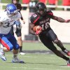 Texas Tech\'s Eric Ward (18) gets past Kansas\' Huldon Tharp during their NCAA college football game in Lubbock, Texas, Saturday, Nov. 10, 2012. (AP Photo/Lubbock Avalanche-Journal, Zach Long) LOCAL TV OUT