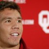University of Oklahoma quarterback Sam Bradford answers a question Tuesday, Oct. 23, 2007, during the college football team\'s weekly media luncheon in Norman, Okla. OU has an open date this week. (AP Photo/The Norman Transcript, Jerry Laizure) ORG XMIT: OKNOT101