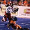 Fresno State\'s Jalen Saunders (6) tries to come up with a catch against the defense of Boise State\'s George Iloka (8) during the second half of an NCAA college football game on Friday, Nov. 19, 2010 in Boise, Idaho. (AP Photo/Matt Cilley)