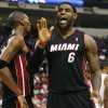 Photo -   Miami Heat's LeBron James (6) and Chris Bosh celebrate following a basket against the Charlotte Bobcats during the second half of an NBA preseason basketball game in Raleigh, N.C., Tuesday, Oct. 23, 2012. Miami won 98-92. (AP Photo/Gerry Broome)