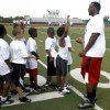Former OU player Gerald McCoy coaches kids during the Reggie Smith Rookie 31 Camp at Edmond Santa Fe on Saturday, June 11, 2011. Photo by Zach Gray, The Oklahoman ORG XMIT: KOD