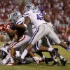 Oklahoma\'s Trey Millard (33) is brought down by a group of Kansas State defenders during a college football game between the University of Oklahoma Sooners (OU) and the Kansas State University Wildcats (KSU) at Gaylord Family-Oklahoma Memorial Stadium, Saturday, September 22, 2012. Oklahoma lost 24-19. Photo by Bryan Terry, The Oklahoman