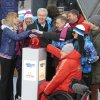 Moscow\'s Mayor Sergei Sobyanin, center, surrounded by various sport enthusiasts and entertainers hits a symbolic button to launch the one-year count down clock for the upcoming 2014 Sochi Olympics in Moscow, Russia, Thursday, Feb. 7, 2013. (AP Photo/Mikhail Metzel)