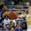Arnett\'s Tyler Tune passes the ball past Coyle\'s Jakobi Brown during the Class B boys state championship game between Coyle and Arnett in the State Fair Arena at State Fair Park in Oklahoma City, Saturday, March 2, 2013. Photo by Bryan Terry, The Oklahoman