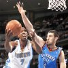 Photo - Nuggets guard Chauncey Billups, left, drives the lane for a shot against the Thunder's Nick Collison.  AP Photo