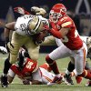 Photo -   New Orleans Saints running back Pierre Thomas (23) is tackled by Kansas City Chiefs cornerback Stanford Routt (26) in the first half of an NFL football game in New Orleans, Sunday, Sept. 23, 2012. (AP Photo/Jonathan Bachman)