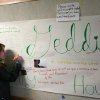 In this photo provided by the Arcata High School Pepperbox, Arcata High School student Blaire Floyd writes on a poster memorial for fellow student Gregory Kulijan Monday, Nov. 26, 2012, at Arcata High School in Arcata, Calif. The Kuljian family were out for a walk Saturday, Nov. 24 at Big Lagoon beach, playing fetch with their dog when Gregory Kuljian tossed a stick that took their dog down to the water\'s edge. Kuljian\'s son ran to save the dog, and struggled as he was captured by the surging surf. Howard Kuljian followed, and later his wife. Both parents\' bodies were later recovered, but the boy, presumed dead, is still missing. (AP Photo/Courtesy Forrest Lewis, Arcata High School Pepperbox)