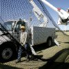 Workers from Edmond Electric use bucket trucks to hang large nets along a fence line behind soccer goals at soccer complex on W Danforth, Wednesday, Oct. 3, 2007. By Jim Beckel, The Oklahoman.
