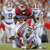 Oklahoma\'s Samaje Perine (32) runs past Louisiana Tech\'s Andre Taylor (84) during a college football game between the University of Oklahoma Sooners (OU) and the Louisiana Tech Bulldogs at Gaylord Family-Oklahoma Memorial Stadium in Norman, Okla., on Saturday, Aug. 30, 2014. Photo by Bryan Terry, The Oklahoman