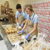 Mac and Heather Carver prepare packages of cookies at Cookie Advantage in Edmond. PAUL HELLSTERN - The Oklahoman