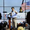 Delegates walks down the hall way in front of a picture showing Republican presidential nominee Mitt Romney is projected on the wall at the Republican National Convention in Tampa, Fla., on Thursday, Aug. 30, 2012. (AP Photo/Patrick Semansky) ORG XMIT: RNC724