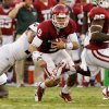 Oklahoma\'s Trevor Knight (9) carries during the first half of the college football game where the University of Oklahoma Sooners (OU) play the University of Louisiana Monroe Warhawks at Gaylord Family-Oklahoma Memorial Stadium in Norman, Okla., on Saturday, Aug. 31, 2013. Photo by Steve Sisney, The Oklahoman