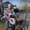 Photo - John Ballard poses with some of the bicycles he repairs to give to  underpriviliged children.  Photo By  Steve Gooch, The Oklahoman