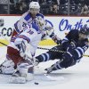 Photo - New York Rangers goaltender Henrik Lundqvist (30) saves the shot from Winnipeg Jets' Jim Slater (19) as Rangers' Martin St. Louis looks on defends during second period NHL action in Winnipeg on Friday, March 14, 2014. (AP Photo/The Canadian Press, John Woods)