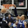 Photo - Dallas Mavericks' Shawn Marion slams in two points in the first quarter of an NBA basketball game against the Minnesota Timberwolves, Monday, Dec. 30, 2013, in Minneapolis. (AP Photo/Jim Mone)