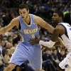 Denver Nuggets small forward Danilo Gallinari (8), of Italy, gets by Dallas Mavericks\' O.J. Mayo (32) on a drive to the basket in the first half of an NBA basketball game on Friday, Dec. 28, 2012, in Dallas. (AP Photo/Tony Gutierrez)