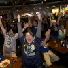 Seattle Seahawks fans Brittney Gutierrez, center, and her husband Mike Gutierrez, left, celebrate while watching Super Bowl XLVIII at Big Al\'s in Vancouver, Wash., Sunday, Feb. 2, 2014. Seattle defeated the Denver Broncos 43-8. (AP Photo/The Columbian, Steven Lane)