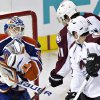 Edmonton Oilers goalie Devan Dubnyk makes the save as Colorado Avalanche\'s Jamie McGinn and Milan Hejduk (23) look for the rebound during the second period of their NHL hockey game, Monday, Jan. 28, 2013, in Edmonton, Alberta. (AP Photo/The Canadian Press, Jason Franson)
