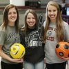 From left, soccer signees Reagan Ballard, UCO, Amanda Dial, ORU, and Lana Duke, OSU, pose for a photo during signing day for student athletes at Edmond Memorial High School in Edmond, Okla., Wednesday, Feb. 5, 2014. Photo by Nate Billings, The Oklahoman